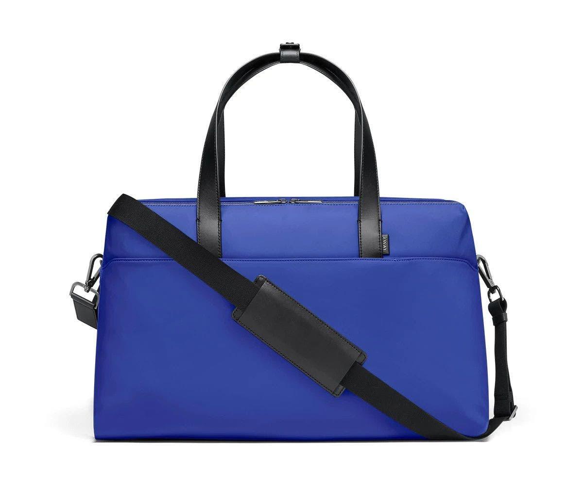 Large shoulder bag in cobalt with raised handles and shoulder strap across the bag.