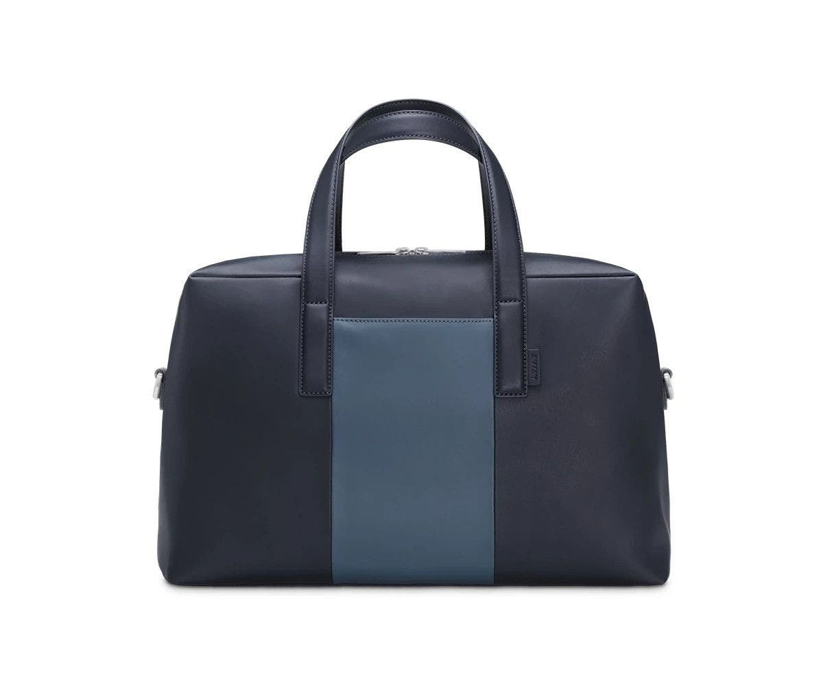 Front of a Coast/Navy duffle bag with raised straps.