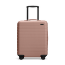 Front view of the Away Dusty Rose/ Taupe Bigger Carry-On hardside showing raised handle.