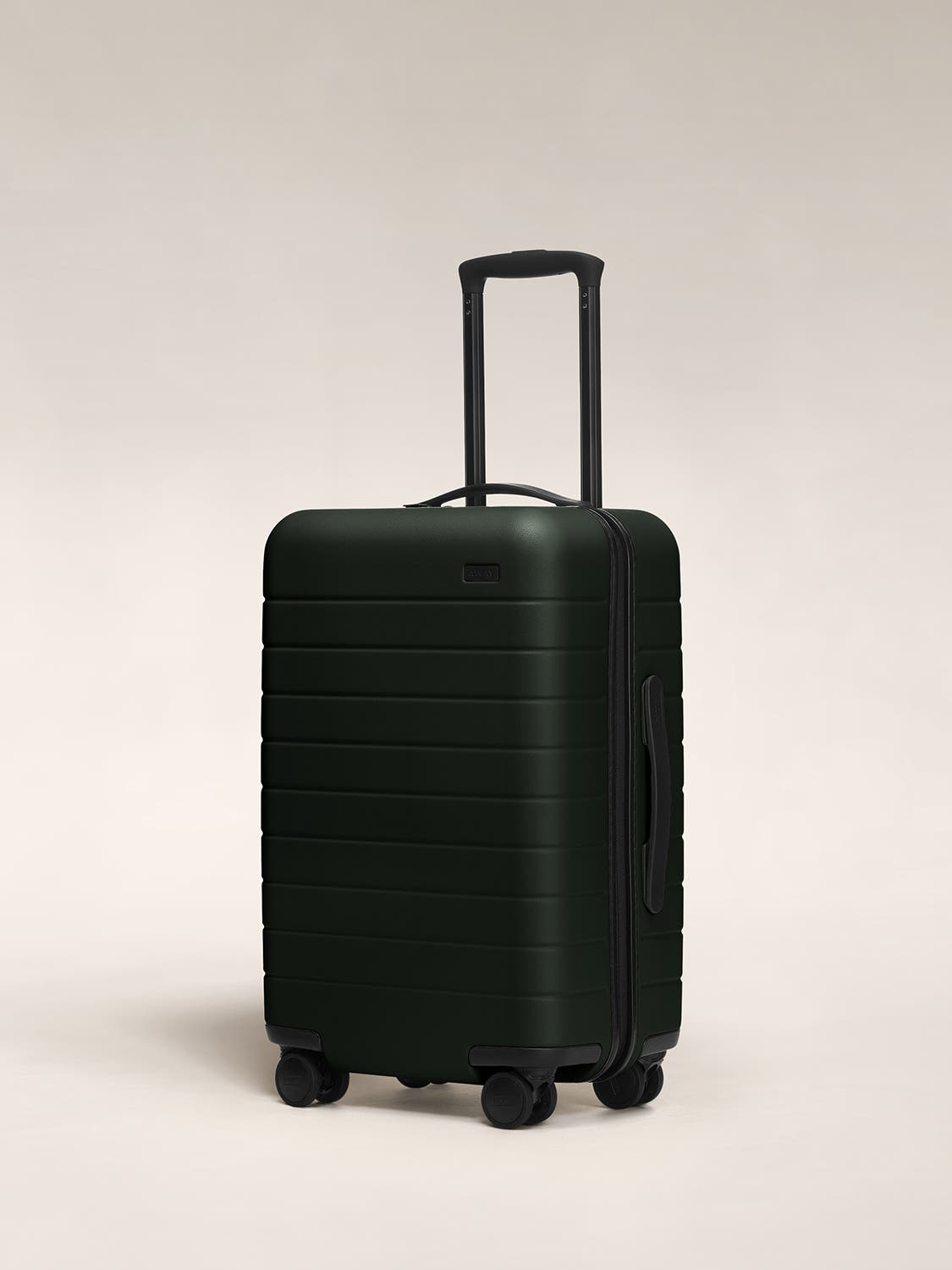 Green carry-on hardside with raised telescopic handles shown at an angle.