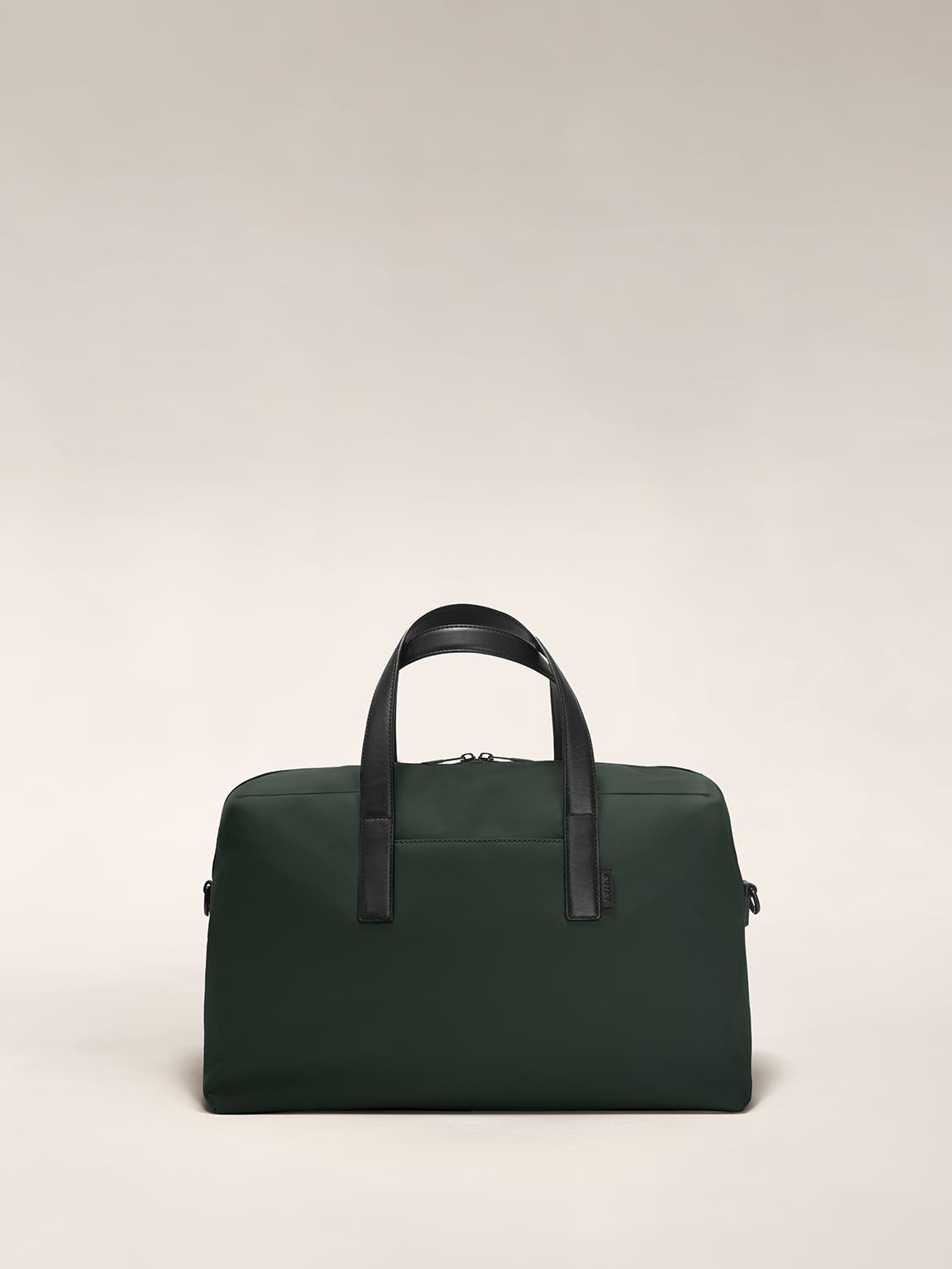 Front of a green duffle bag with raised straps.