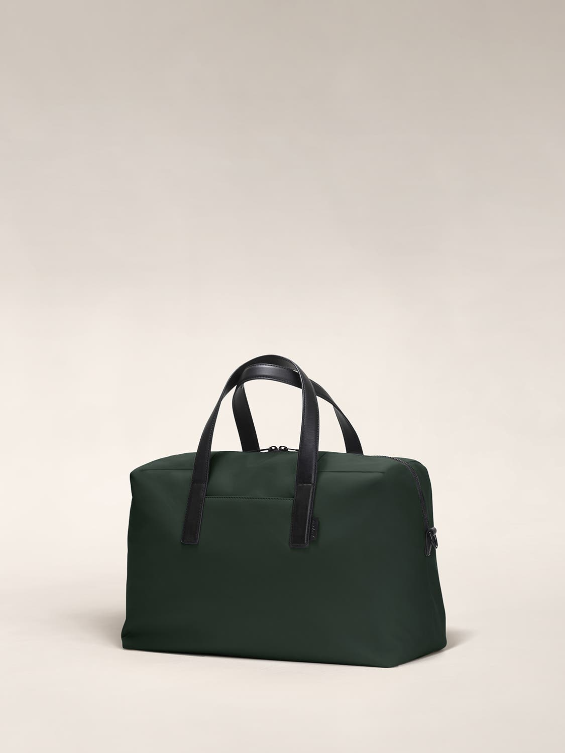 Angled view of a green duffle bag with crossed straps.
