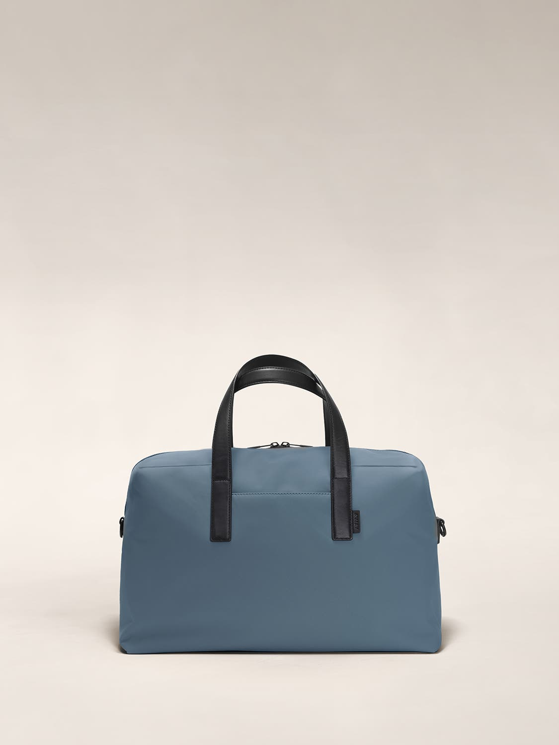 Front of a coast blue duffle bag with raised straps.
