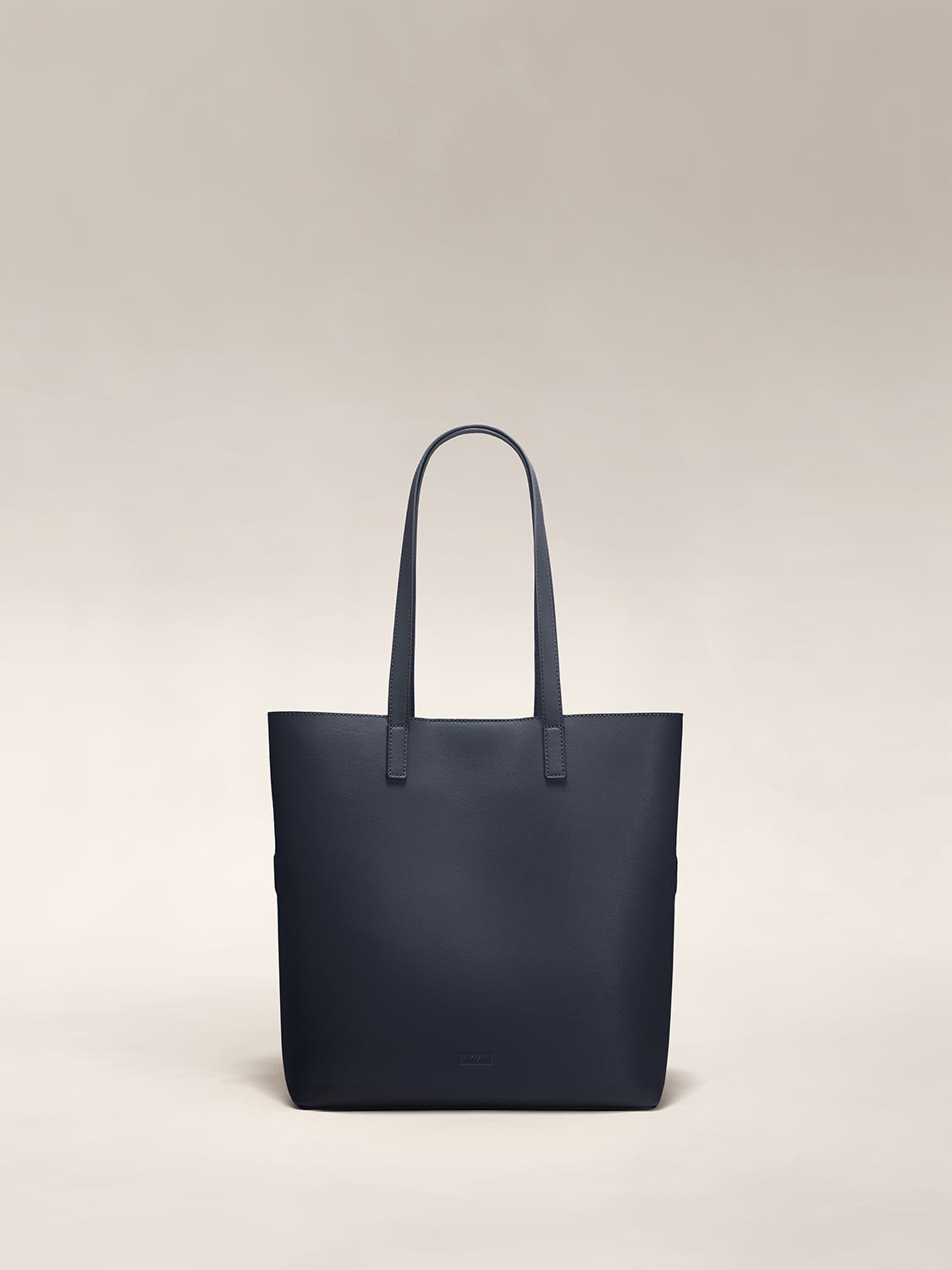 A navy tote shoulder bag in leather.