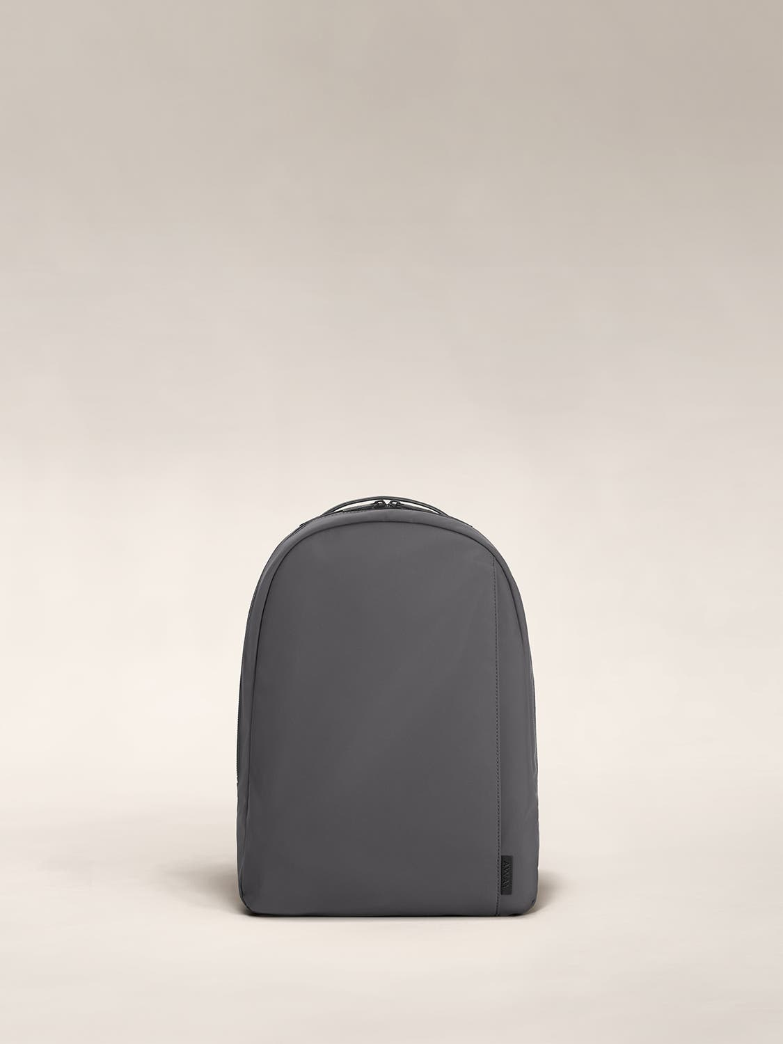 Front view of a gray small backpack.