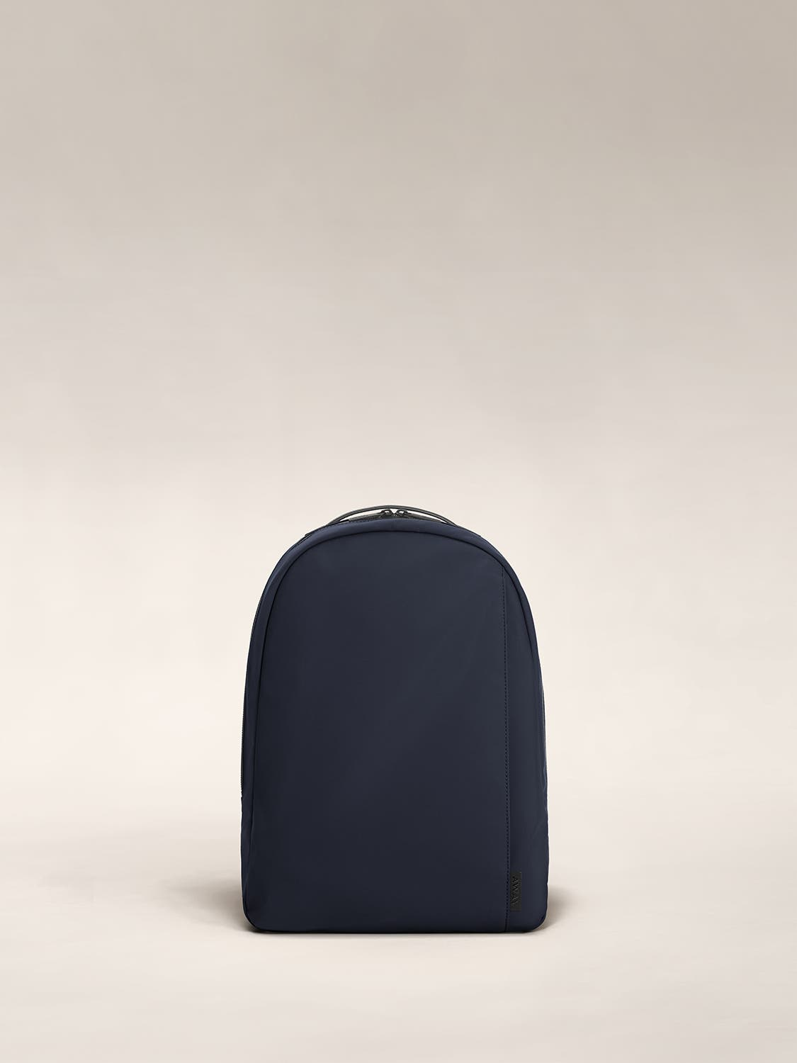 Front view of a navy small backpack.