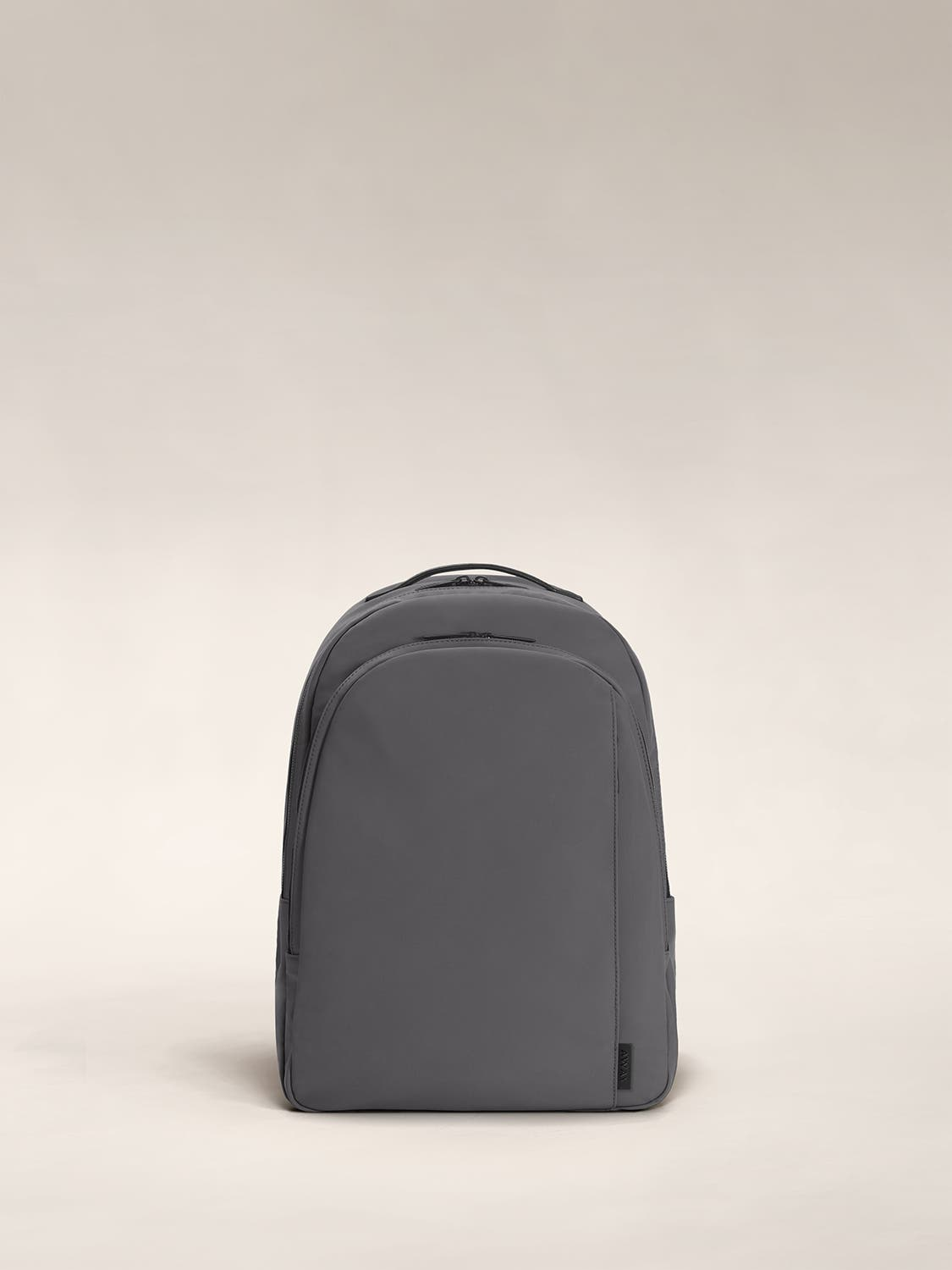 Asphalt color backpack with one large zip compartment and one small one.