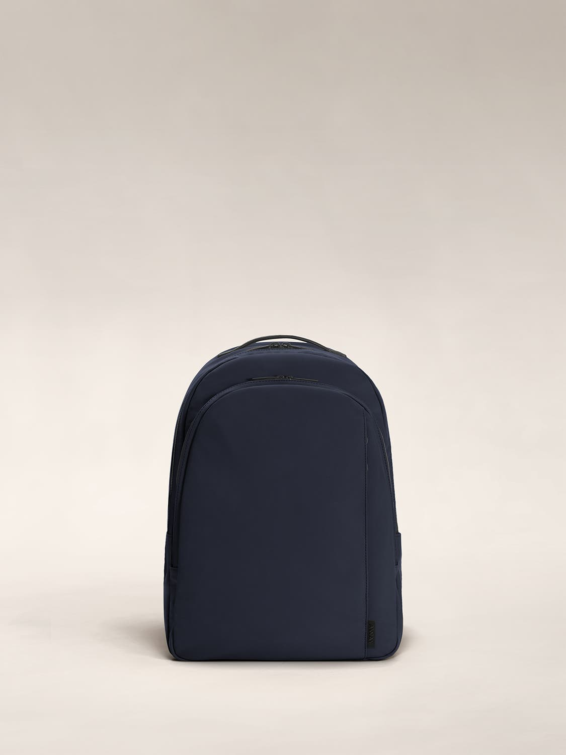 Navy color backpack with one large zip compartment and one small one.