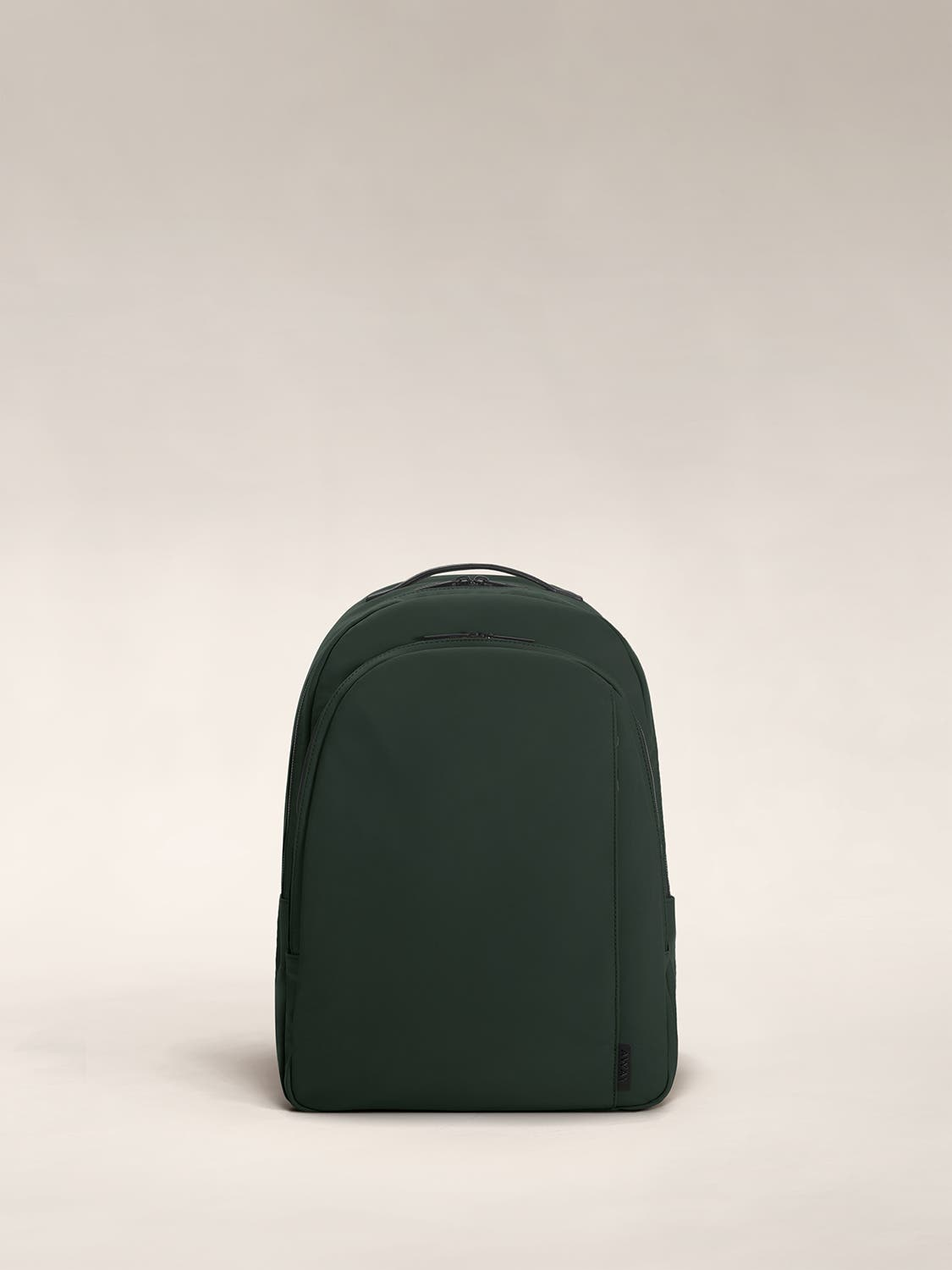 Green color backpack with one large zip compartment and one small one.