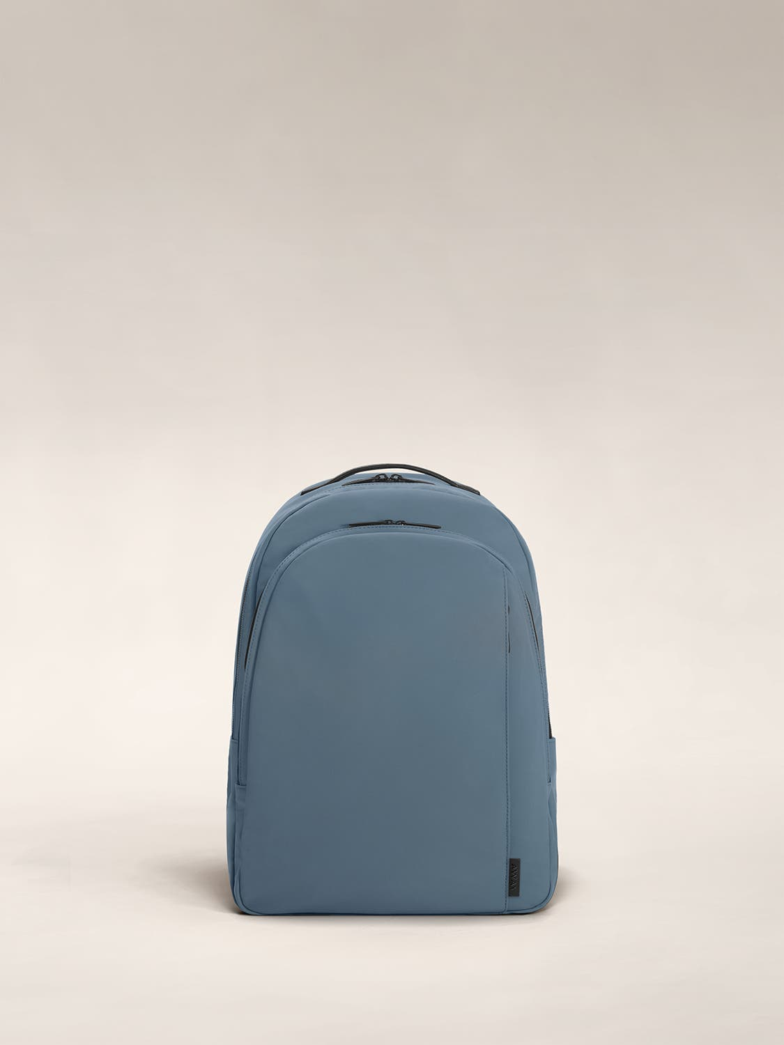 Coast blue color backpack with one large zip compartment and one small one.