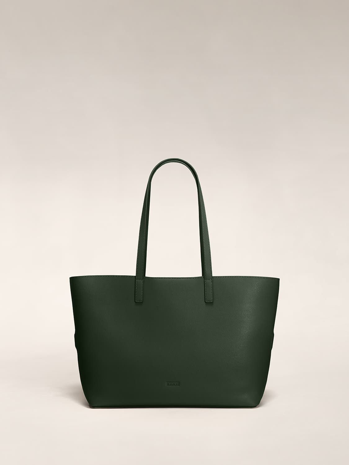 A pine tote shoulder bag in leather.