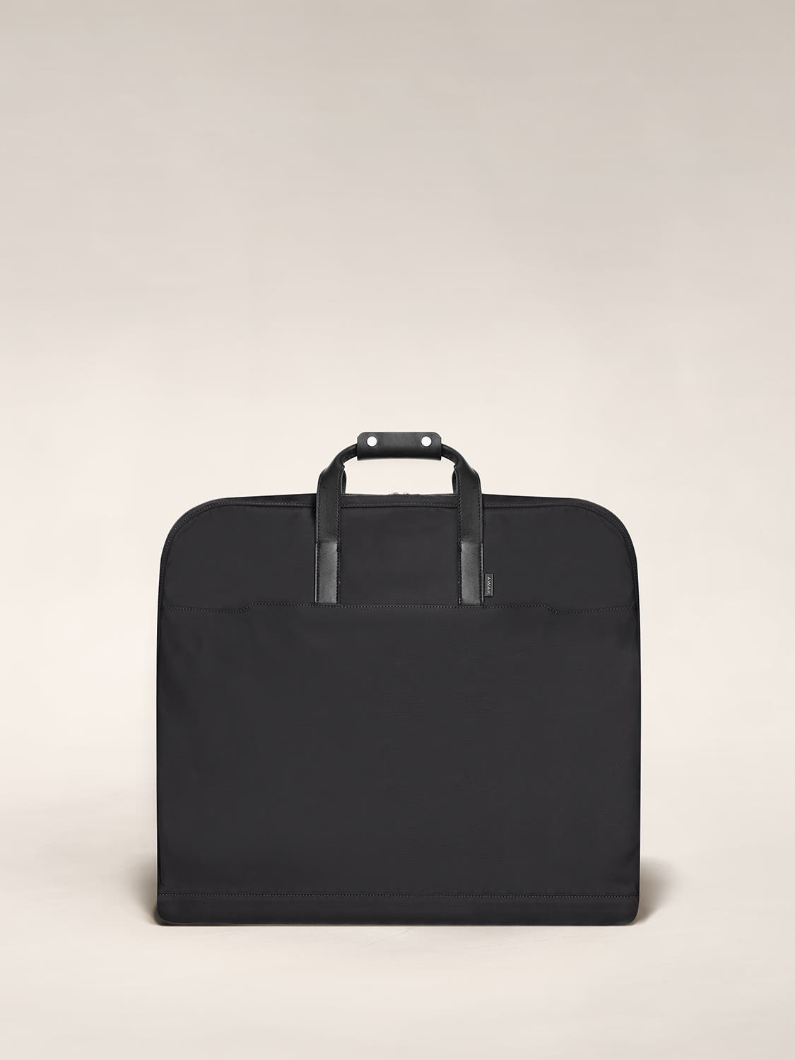 Black garment bag folded view with leather trim handles.