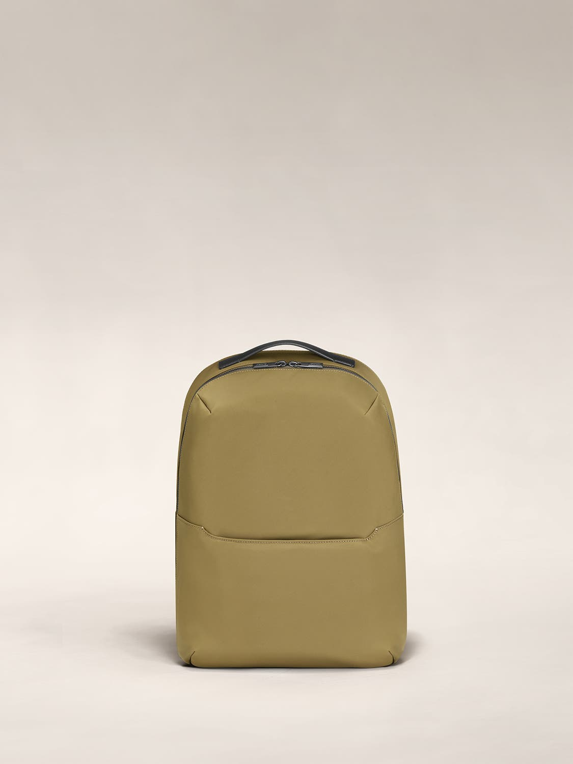 Front view of a moss green backpack.