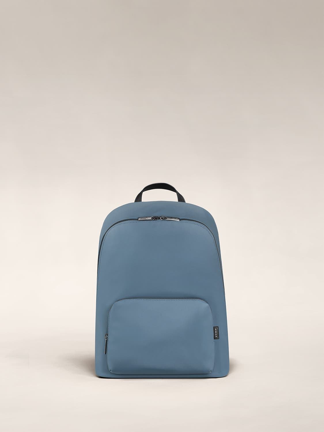 Front of a cost blue backpack with two pockets one main and one small with zip.