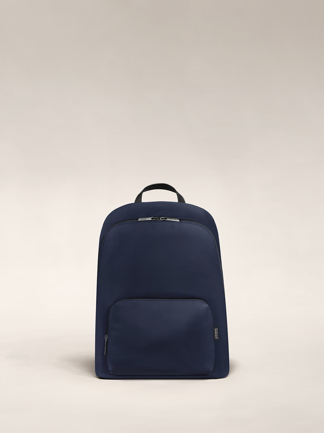 Front of a navy blue backpack with two pockets one main and one small with zip.