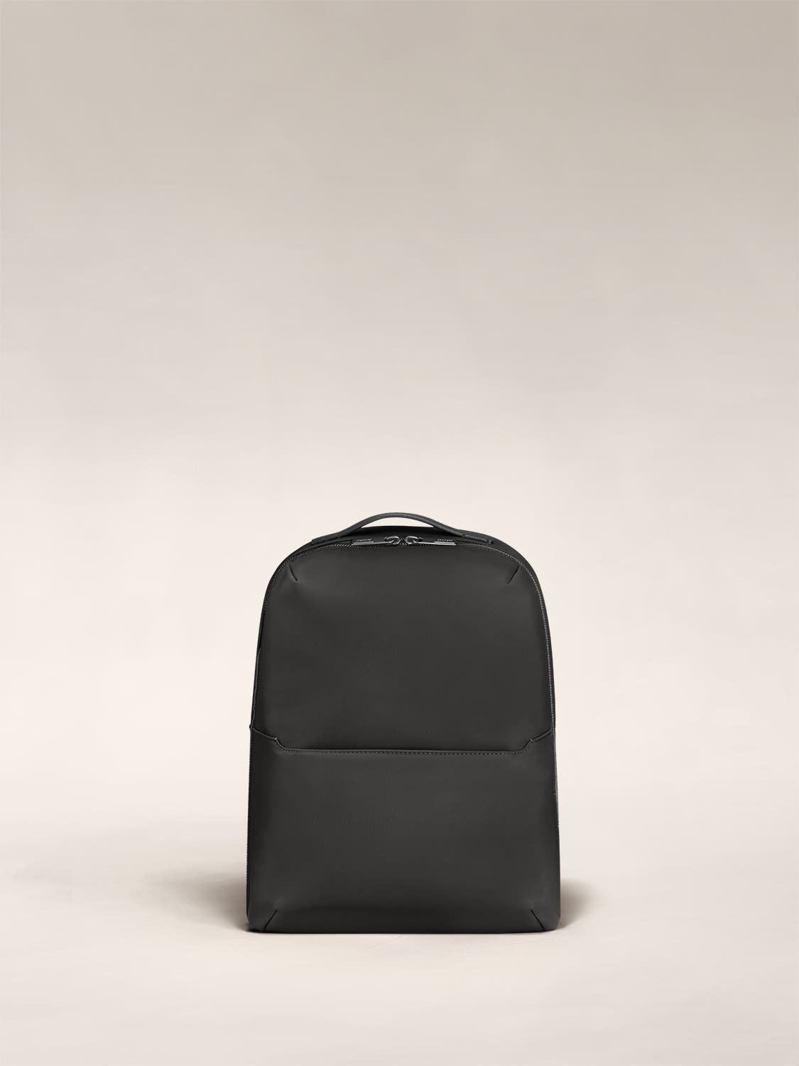 Small backpack in black with one small pocket in the front.