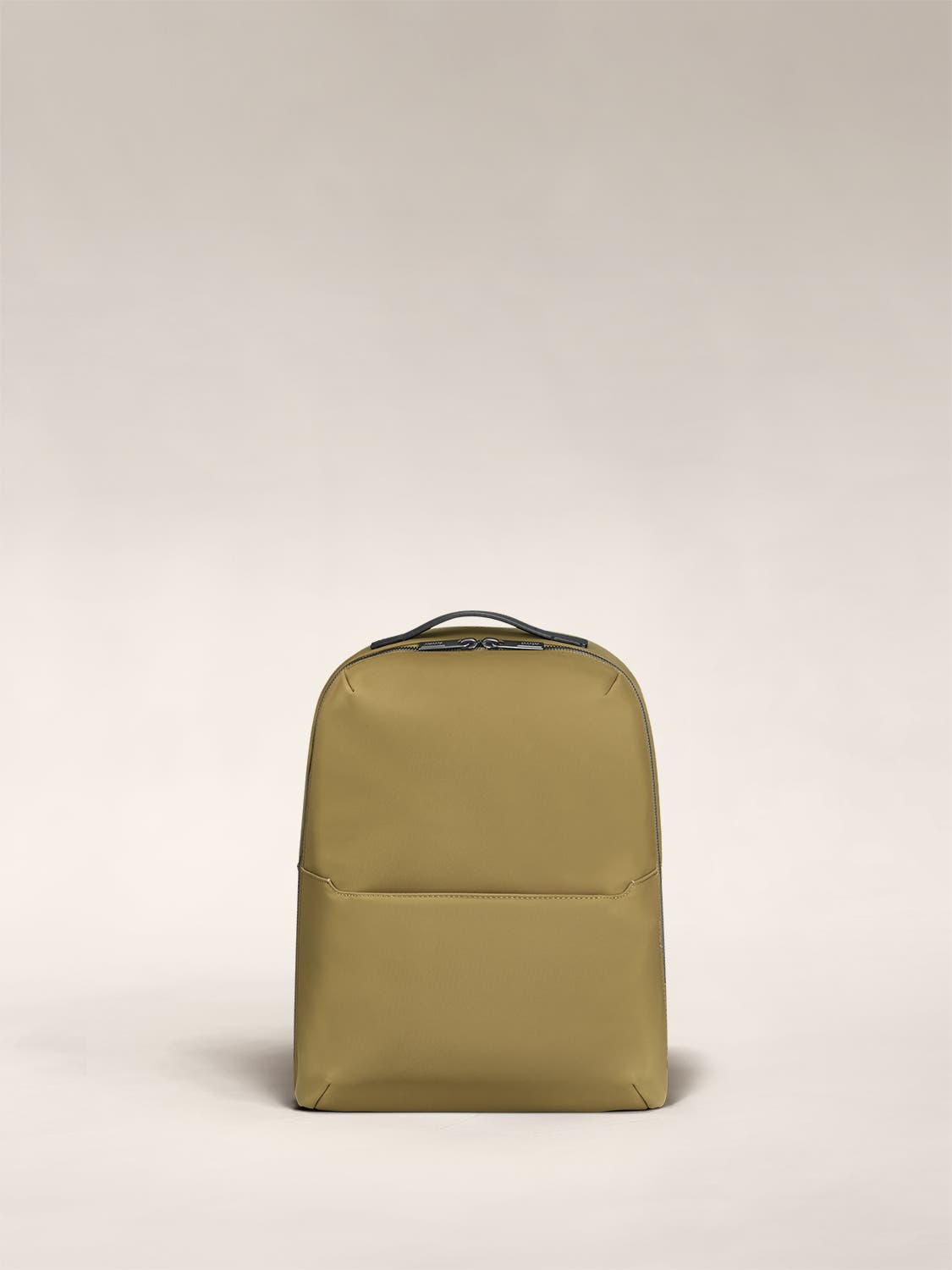Small backpack in moss green with one small pocket in the front.