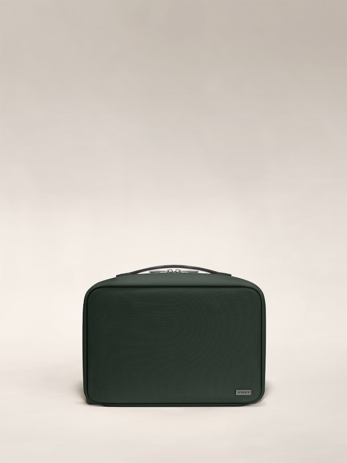 Front view of a green toiletry bag with handle on top.
