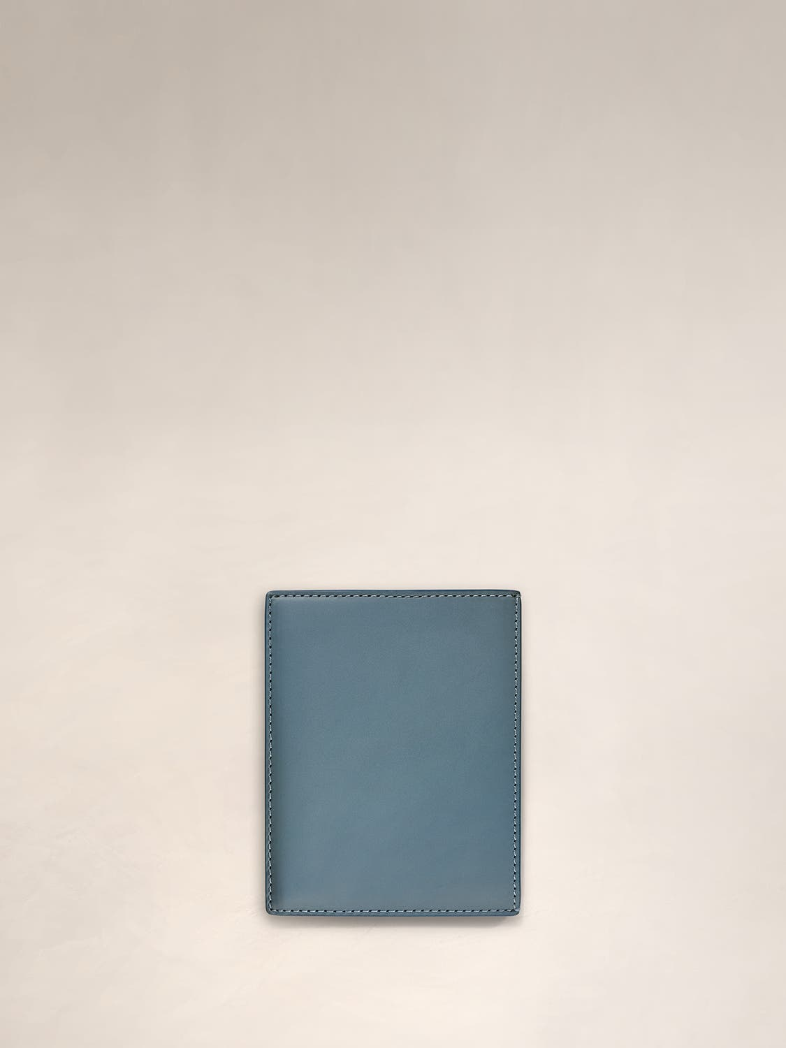 A front view of a coast passport holder.