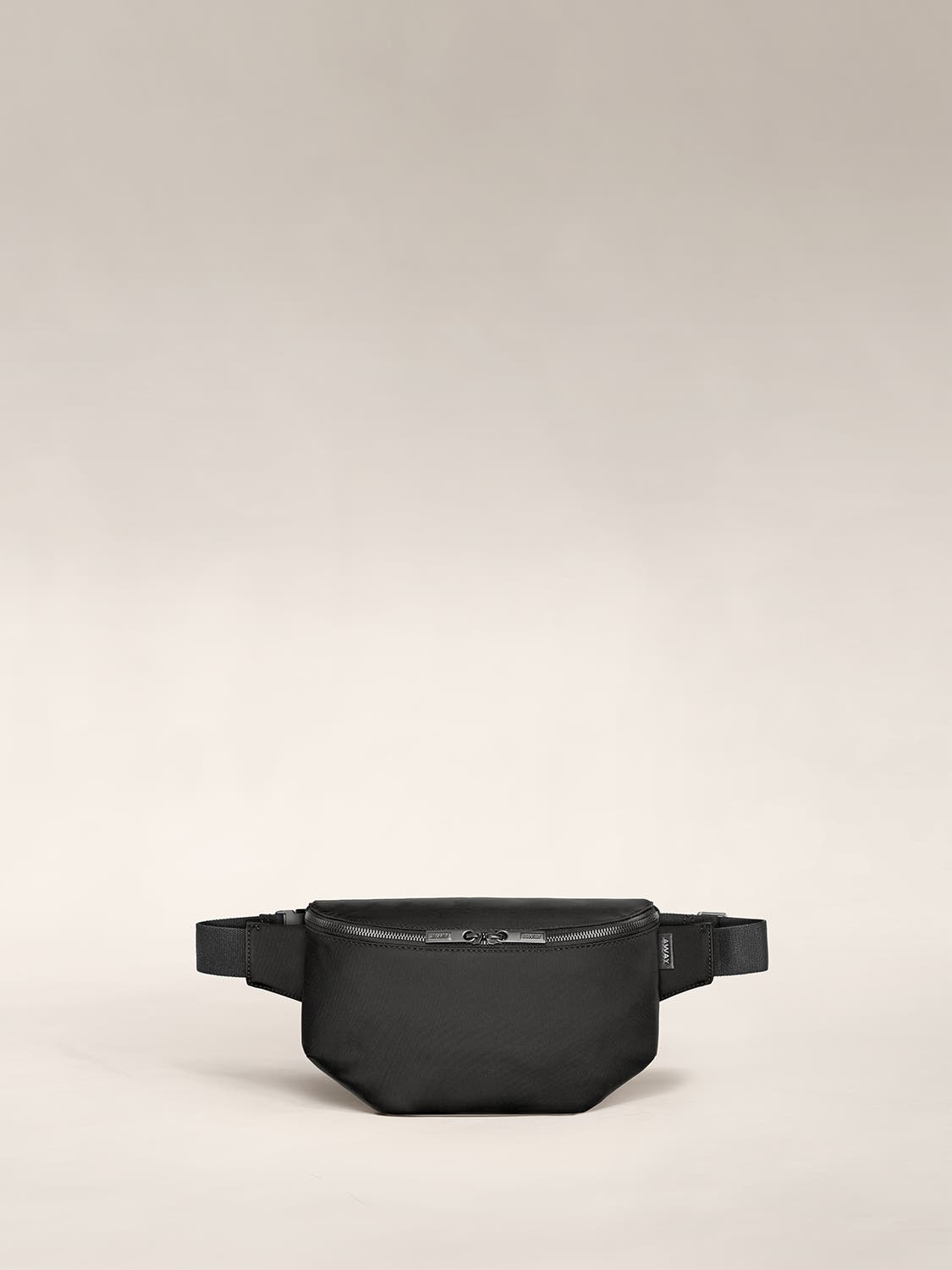 A front view of a sling bag in black.