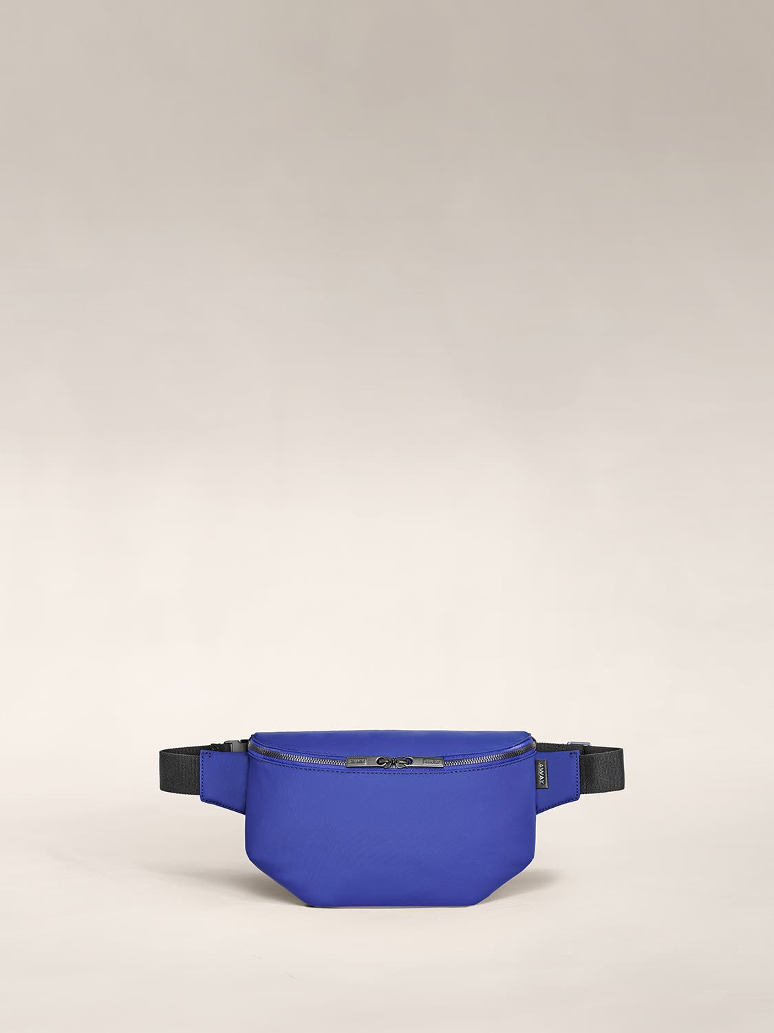 A front view of a sling bag in cobalt.