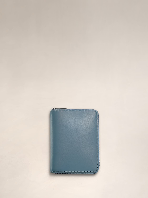 A coast wraparound zip wallet for travel.