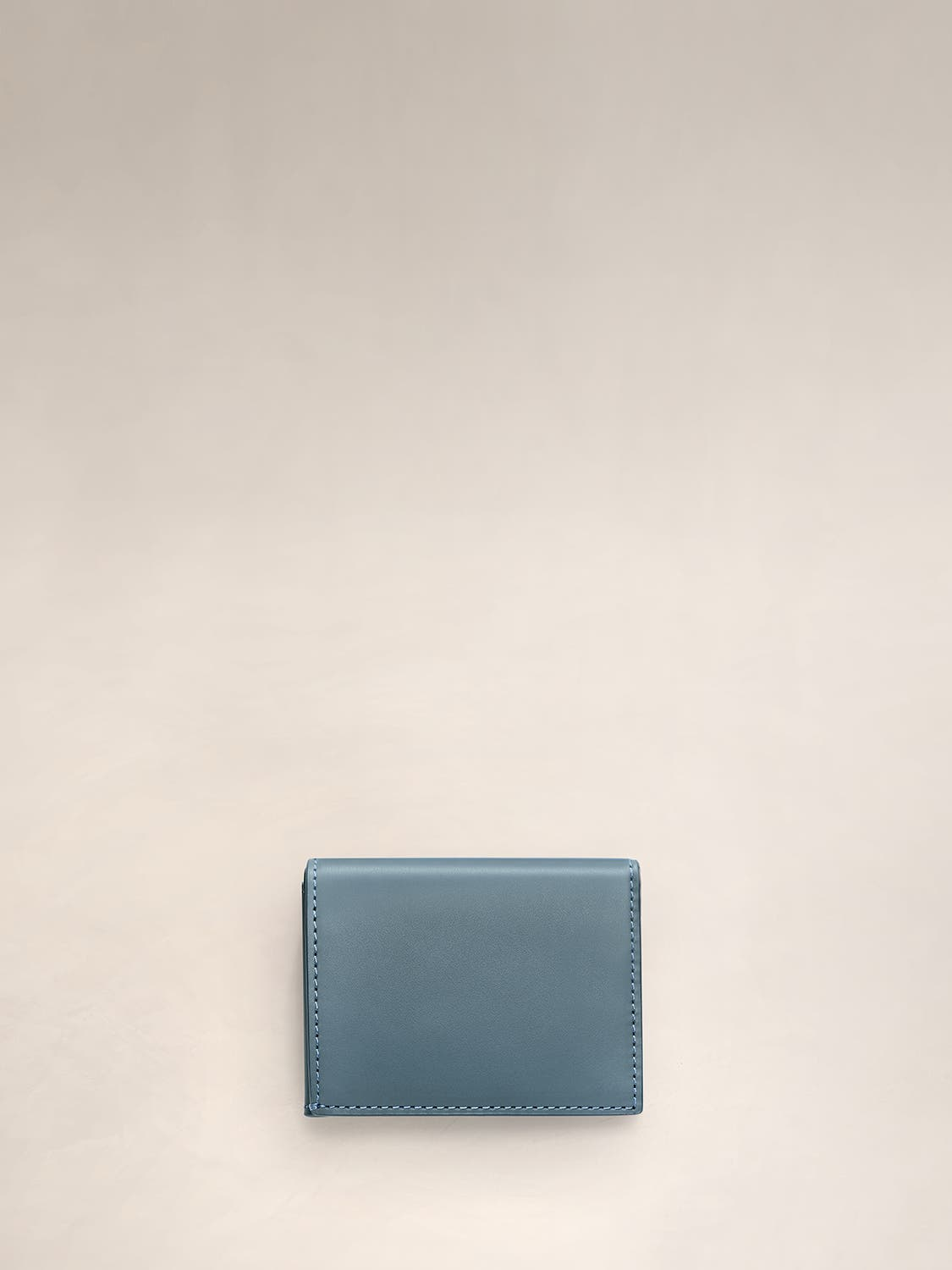 A coast L-Fold wallet for travel.
