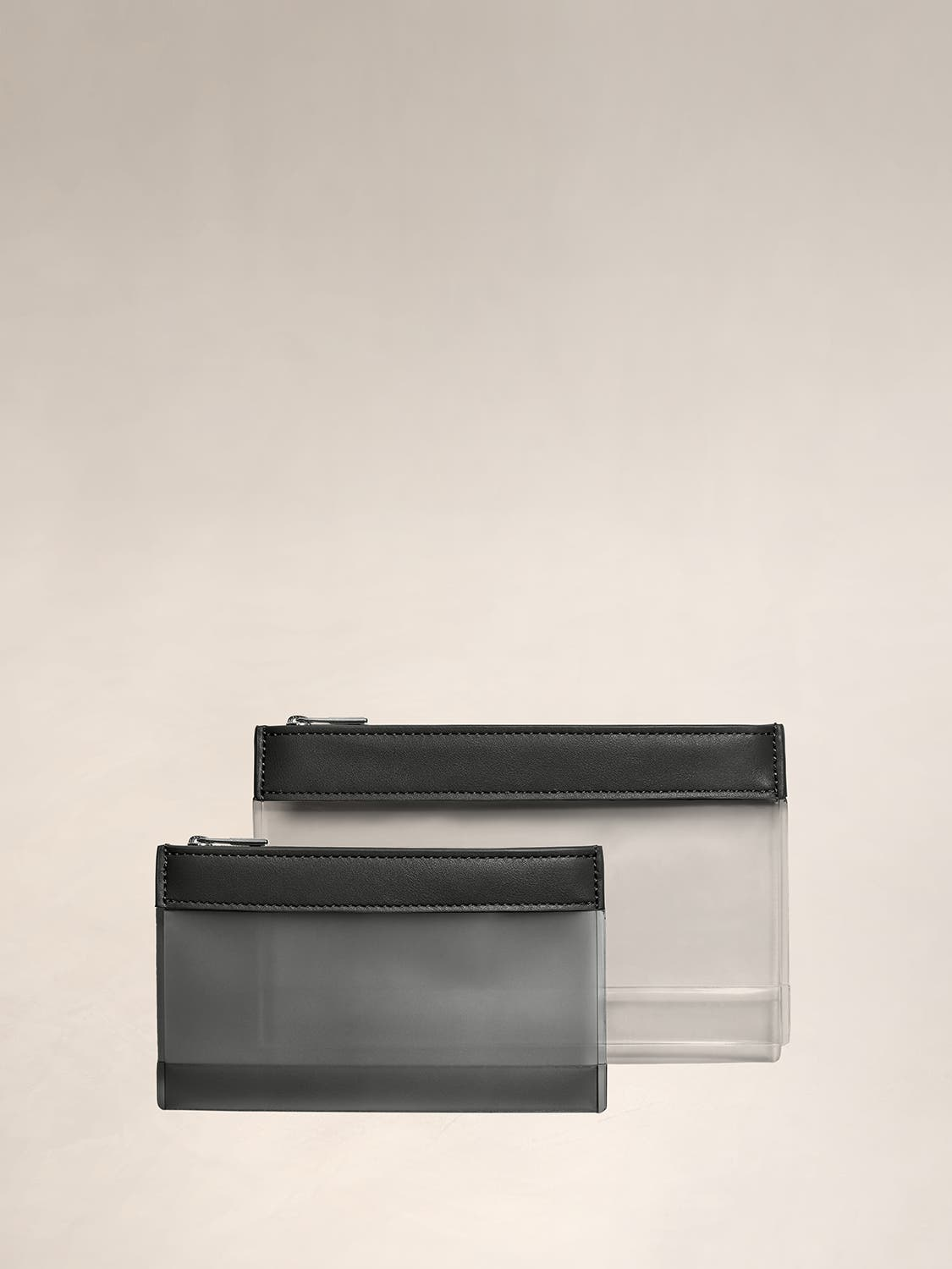 A TSA approved clear pouch set for travel and toiletries.