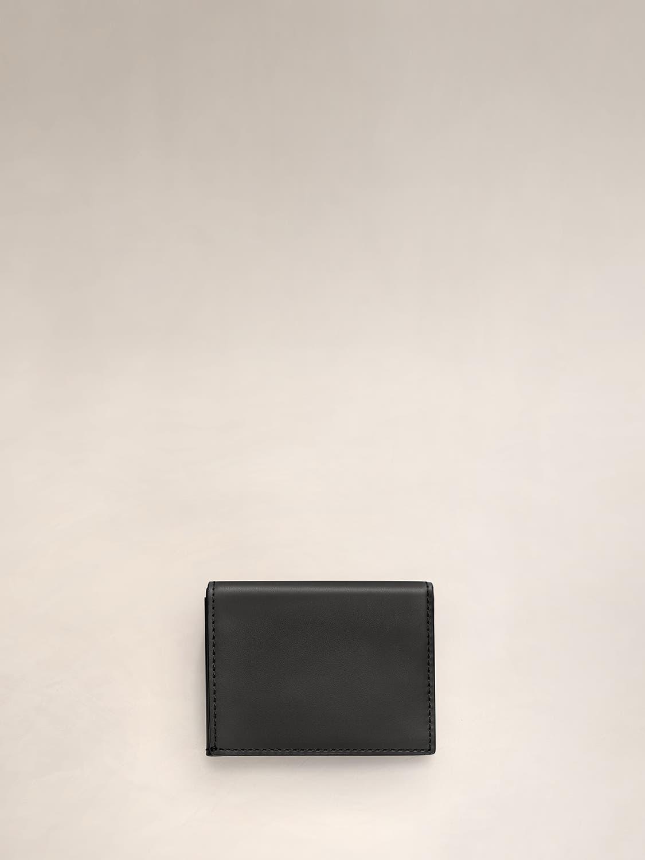 A black L-Fold wallet for travel.