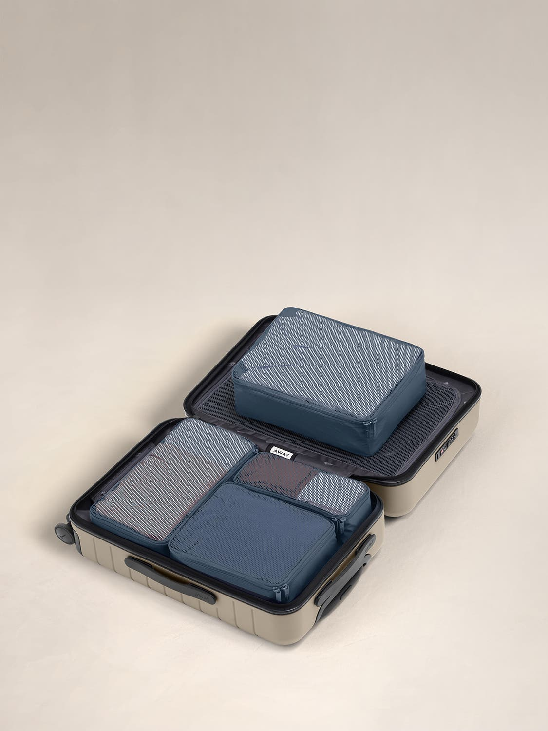 Coast travel packing cubes displayed in an Away suitcase