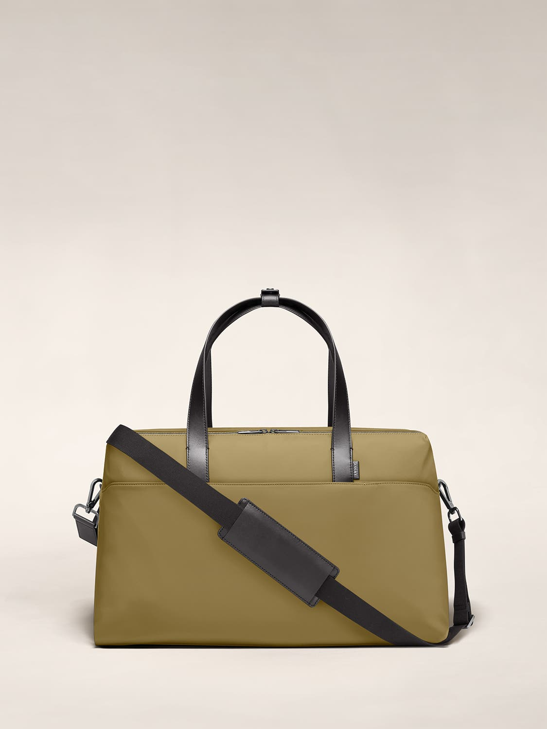 Large duffle bag in olive with raised handles and shoulder strap across the bag.