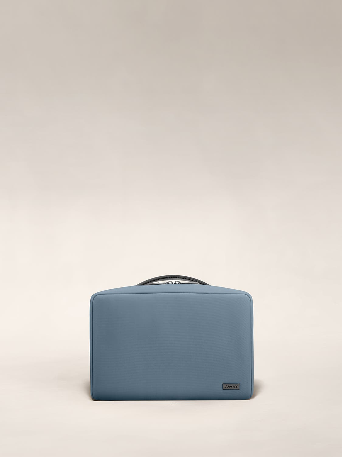 Small travel toiletry bag in the color coast by Away.