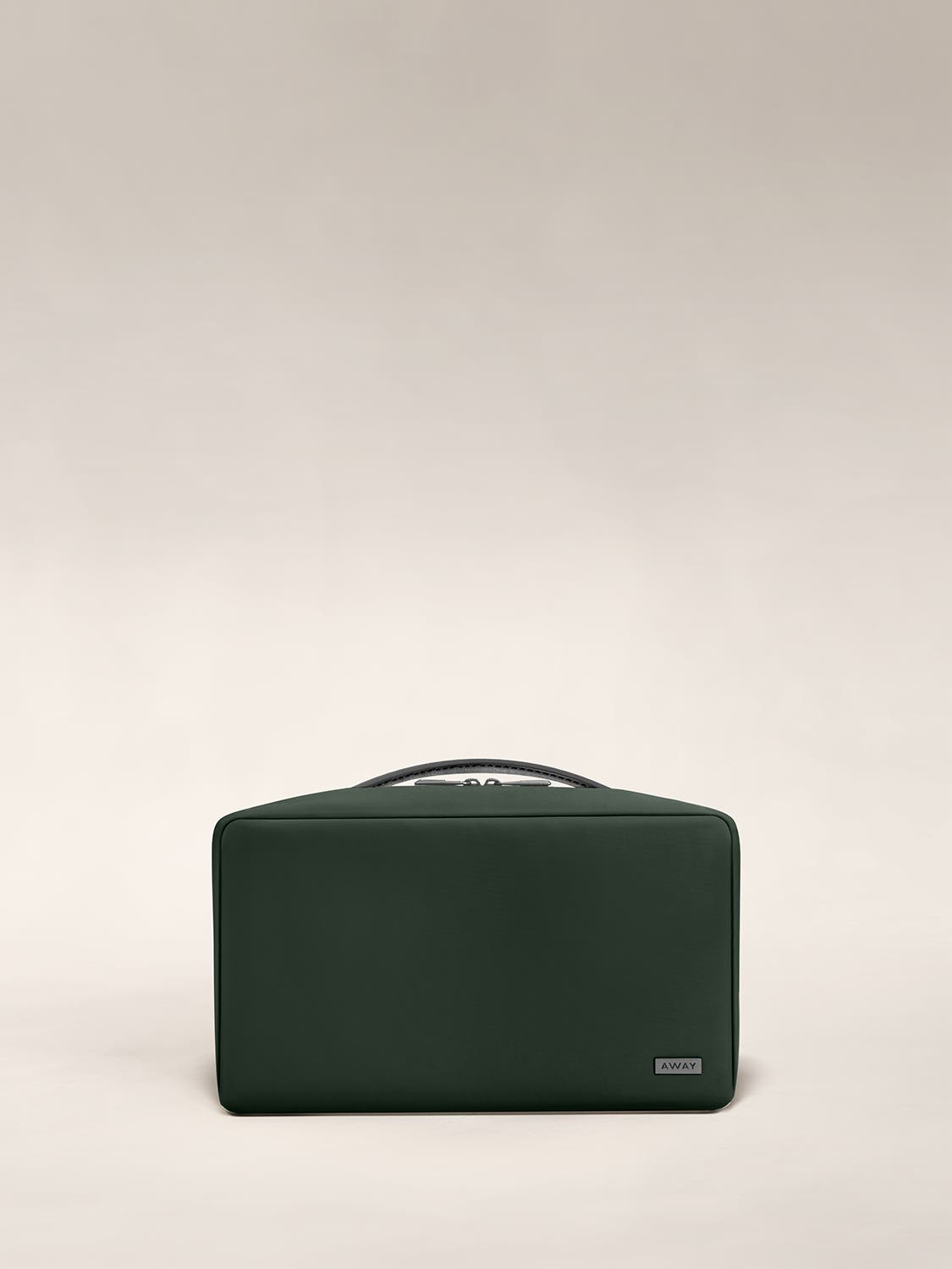 Large travel toiletry bag in the color green.