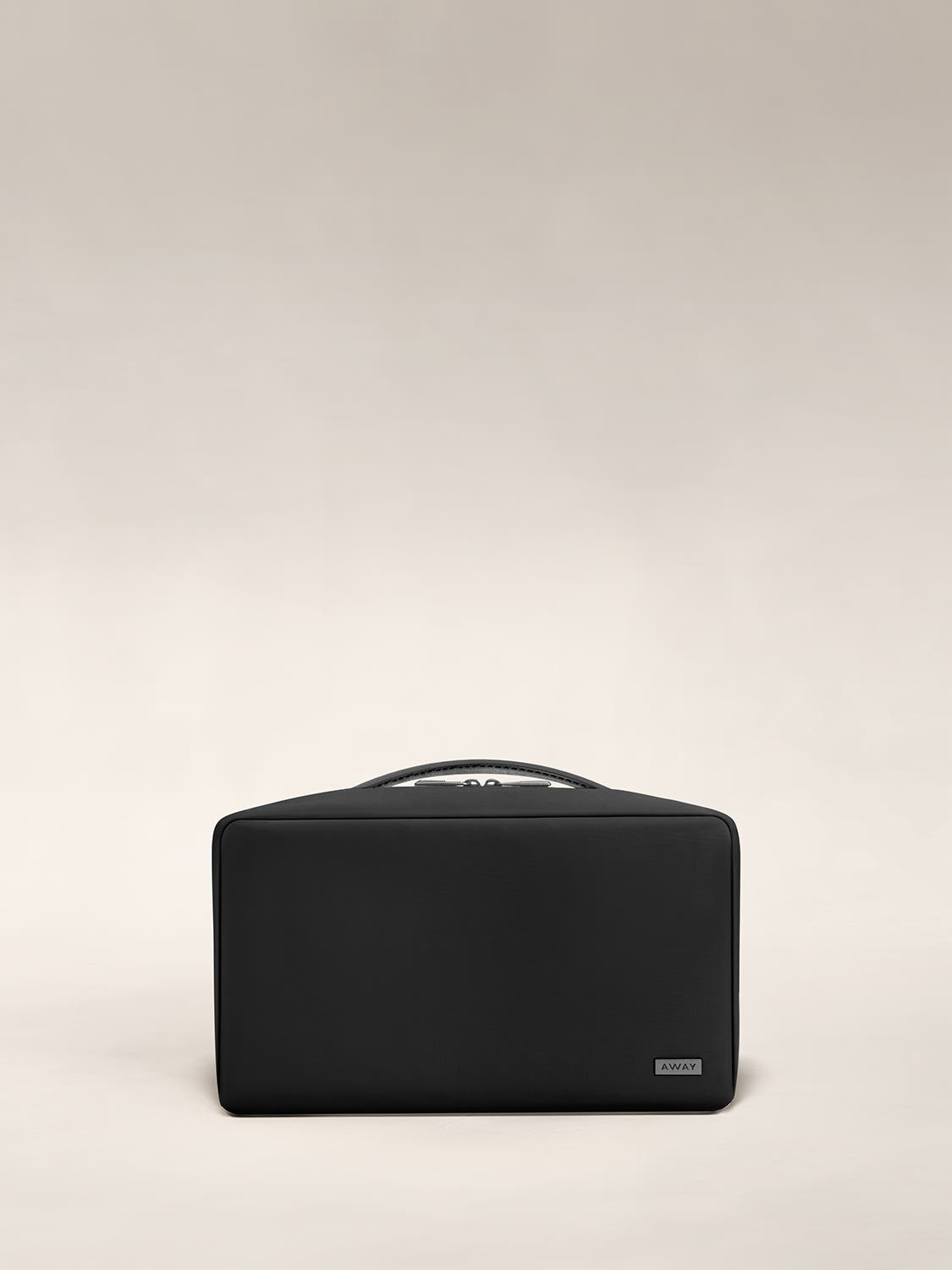 Large travel toiletry bag in the color black.