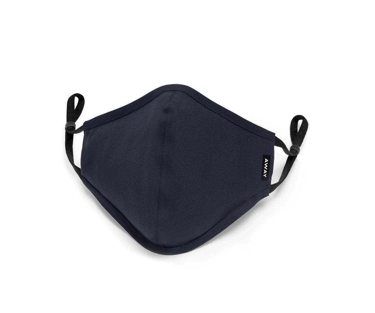 A front view of a reusable cloth face mask in navy blue.