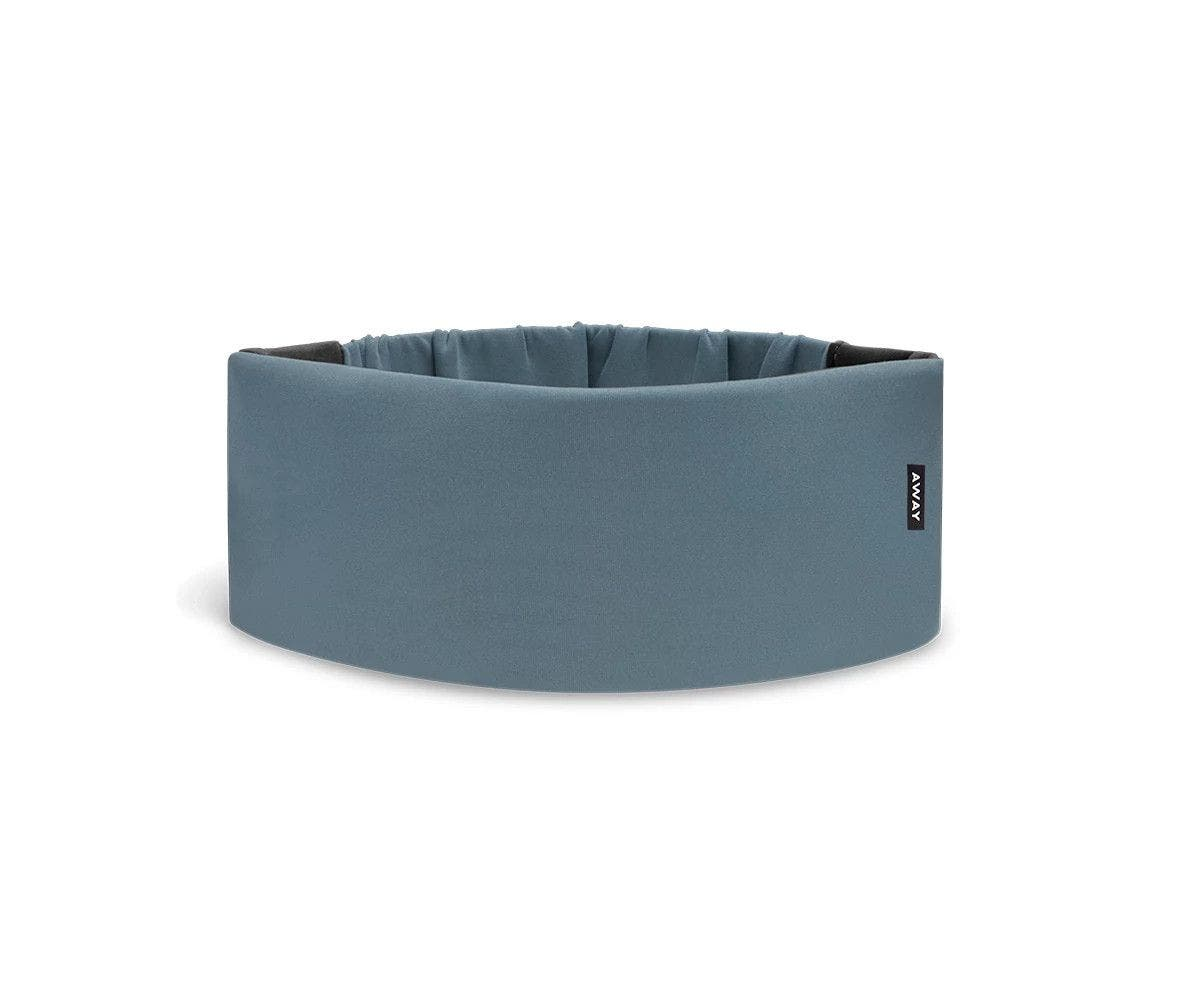 A cushioned blue travel sleep mask by Away.