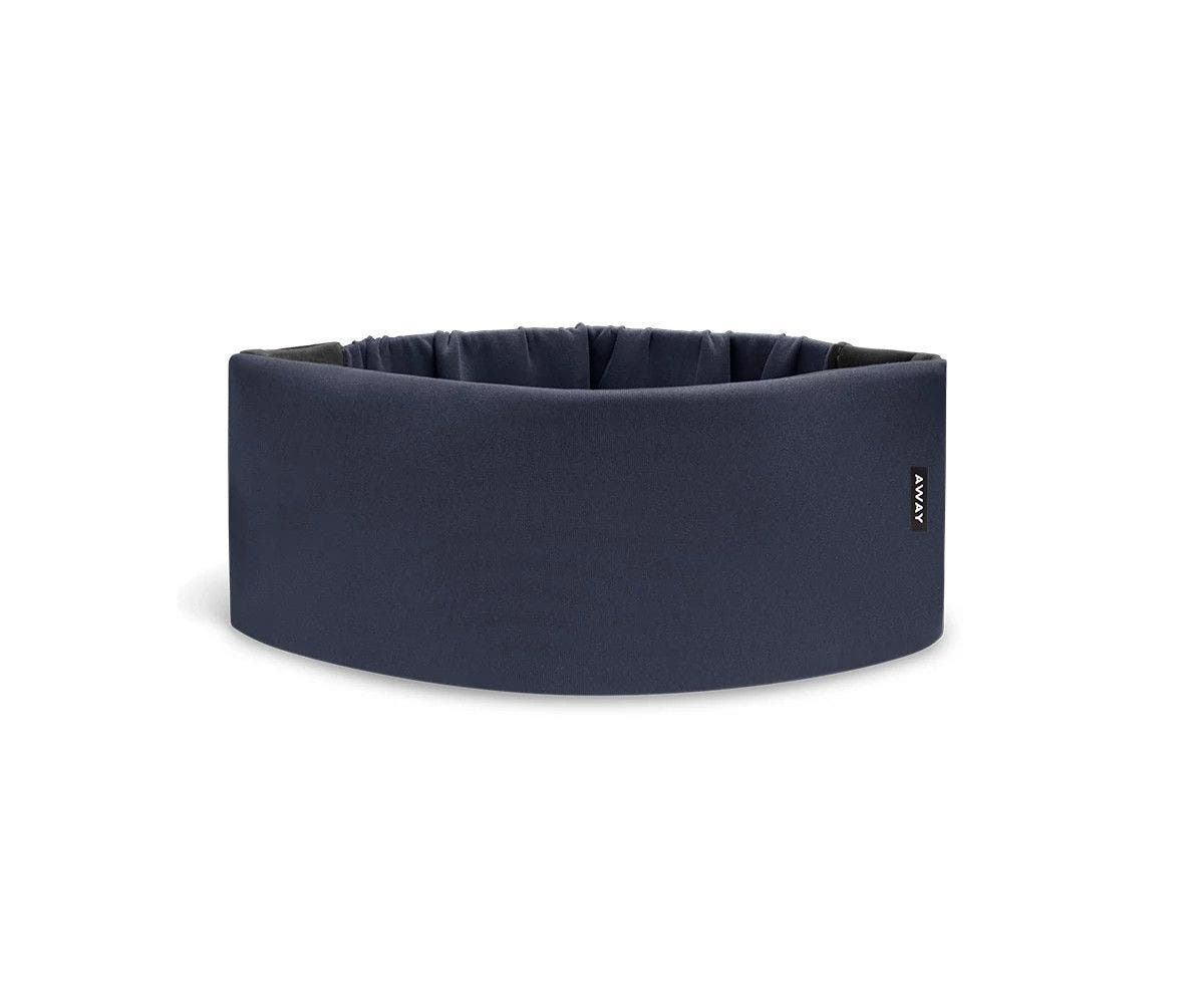 A cushioned navy blue travel sleep mask by Away.