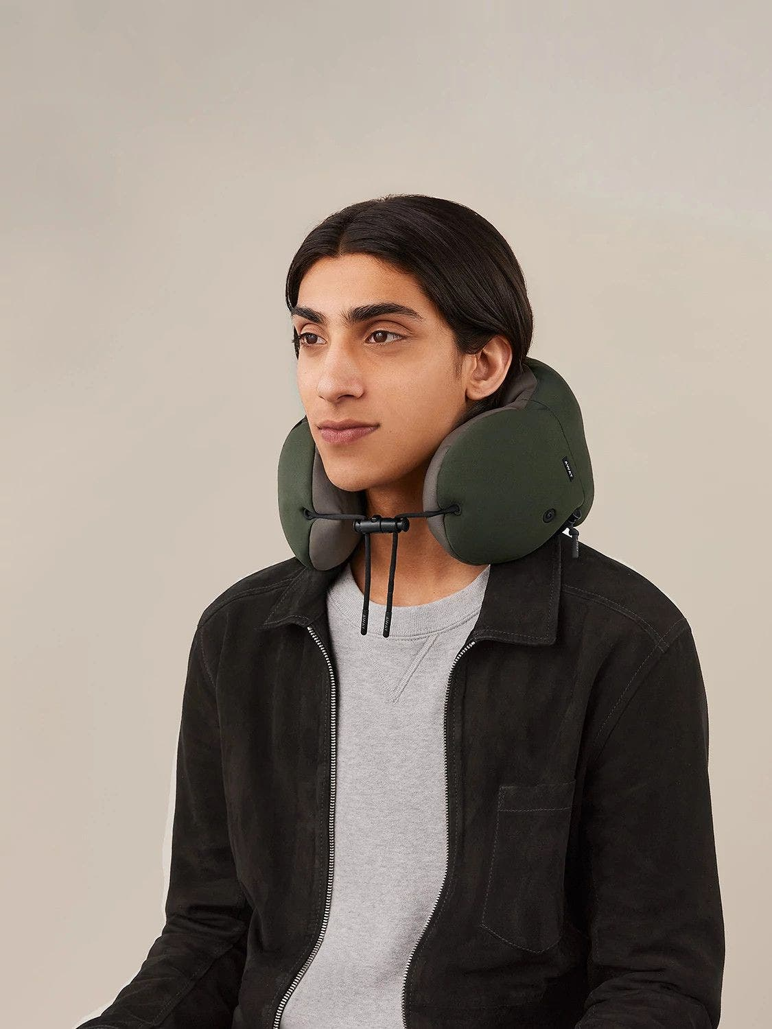 A person wearing a travel neck pillow.