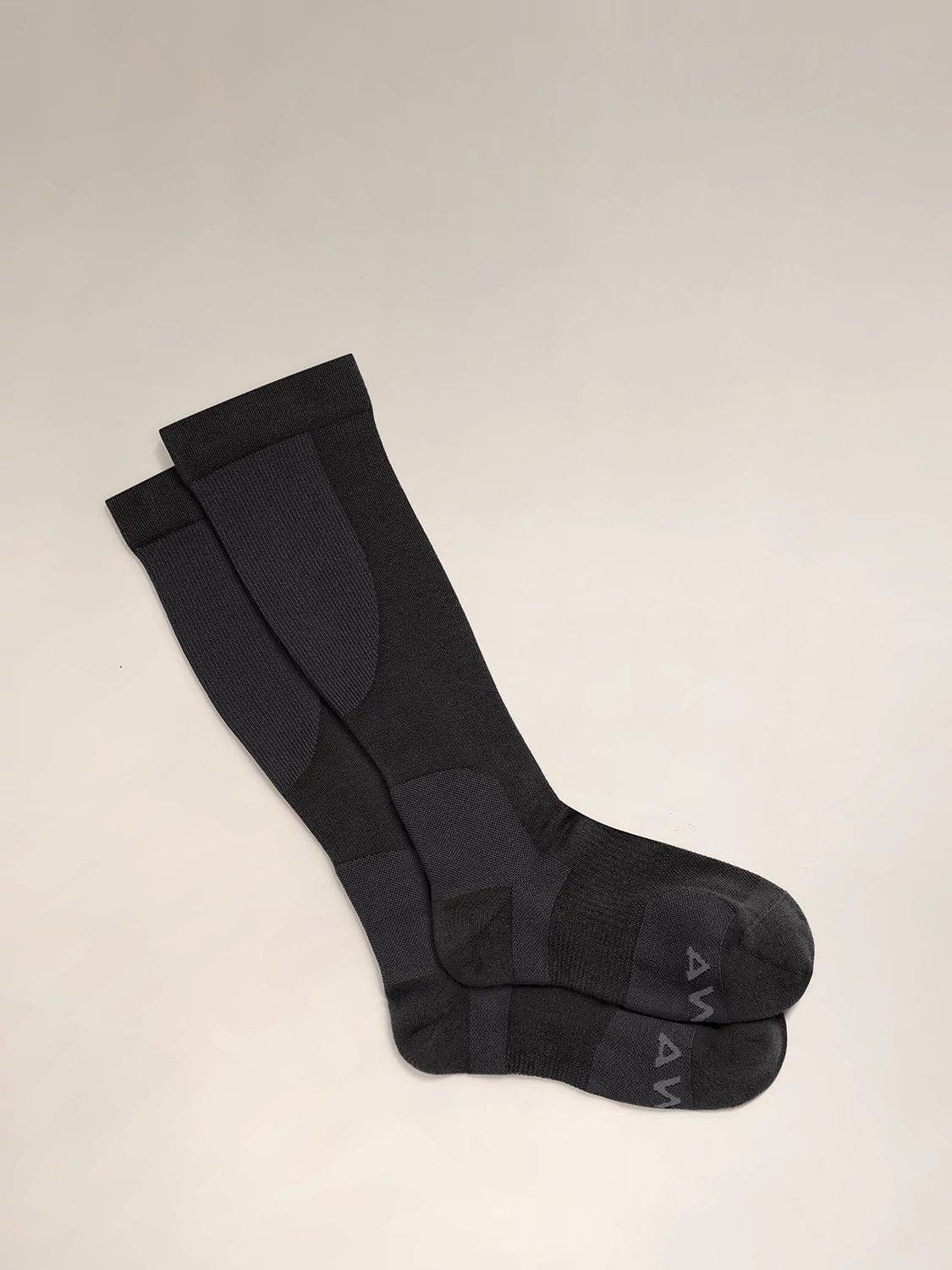 A pair of black travel compression socks.