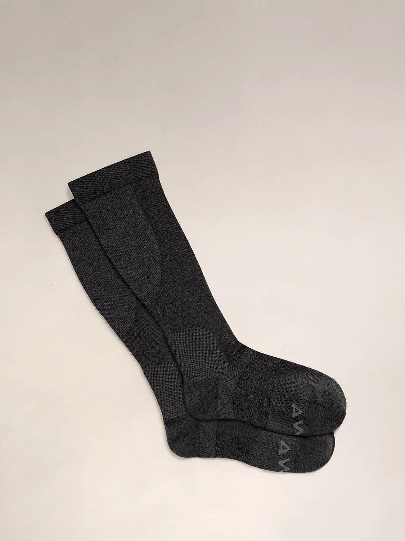 A pair of black travel compression socks.