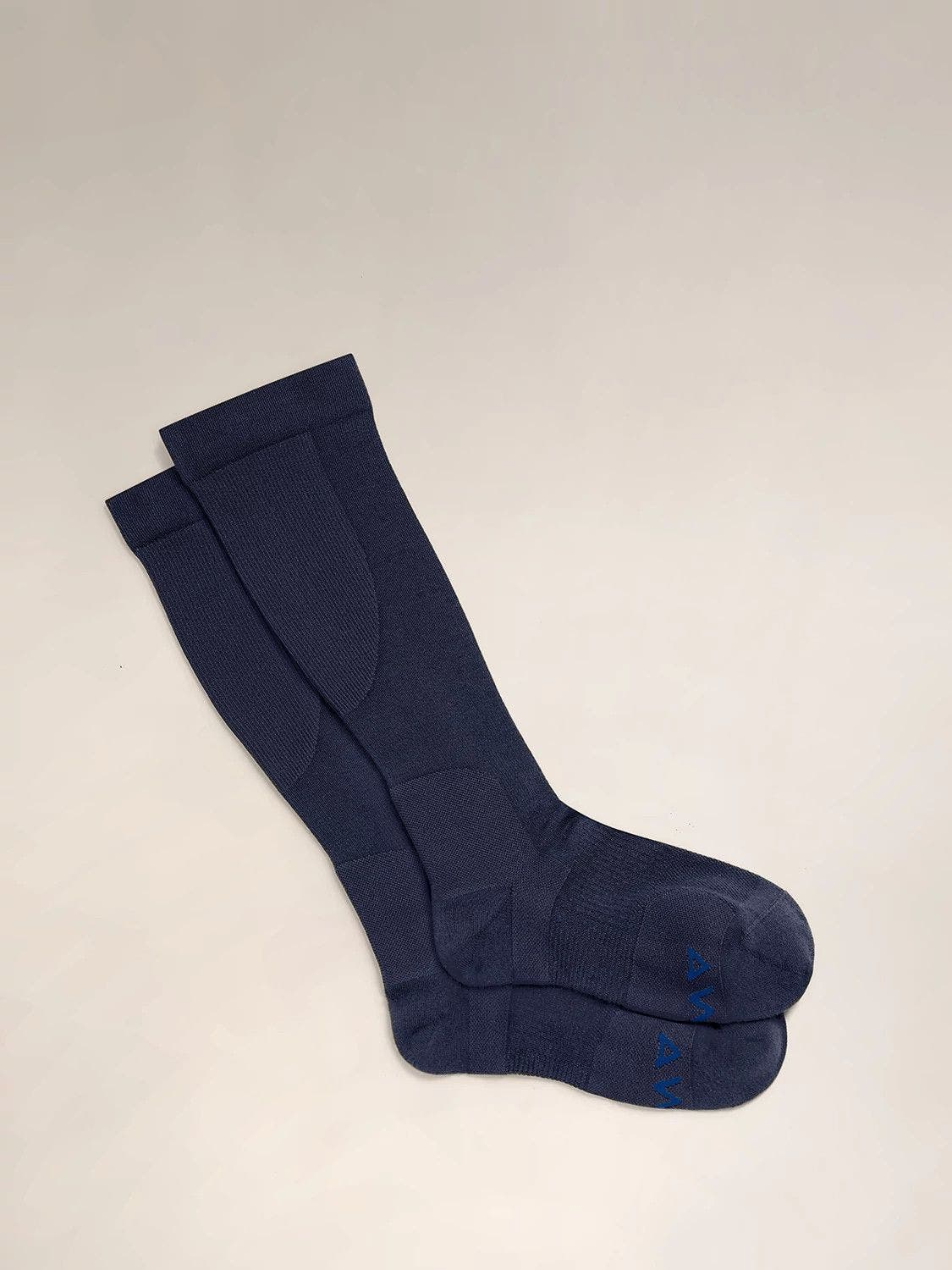 A pair of navy compression socks for travel comfort.