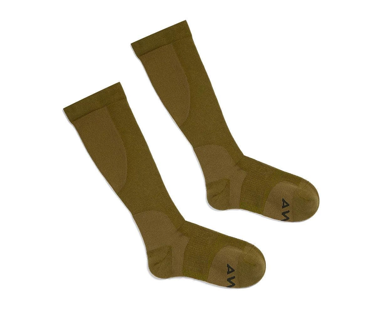 A pair of olive brown compression socks for travel comfort.