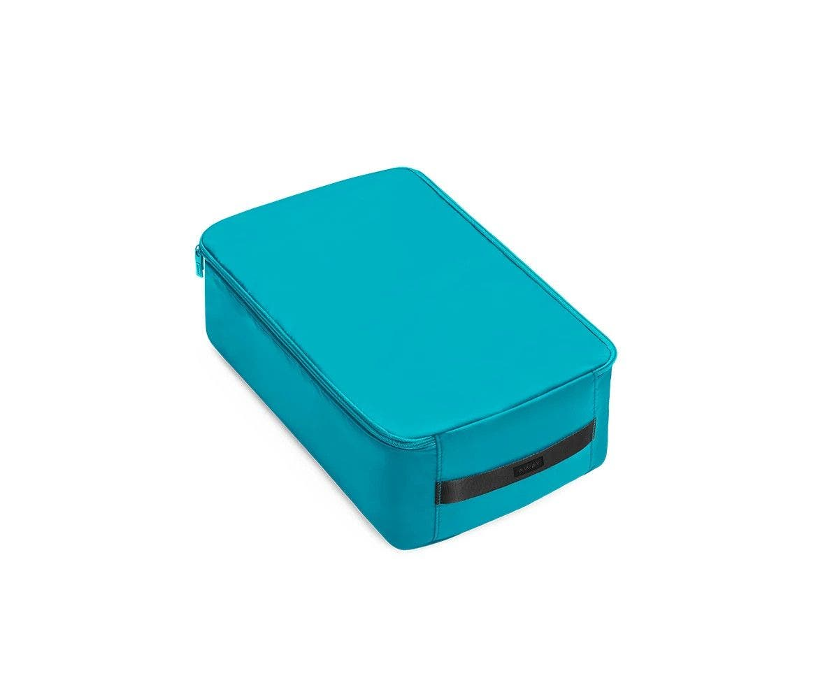 A large bright teal shoe cube