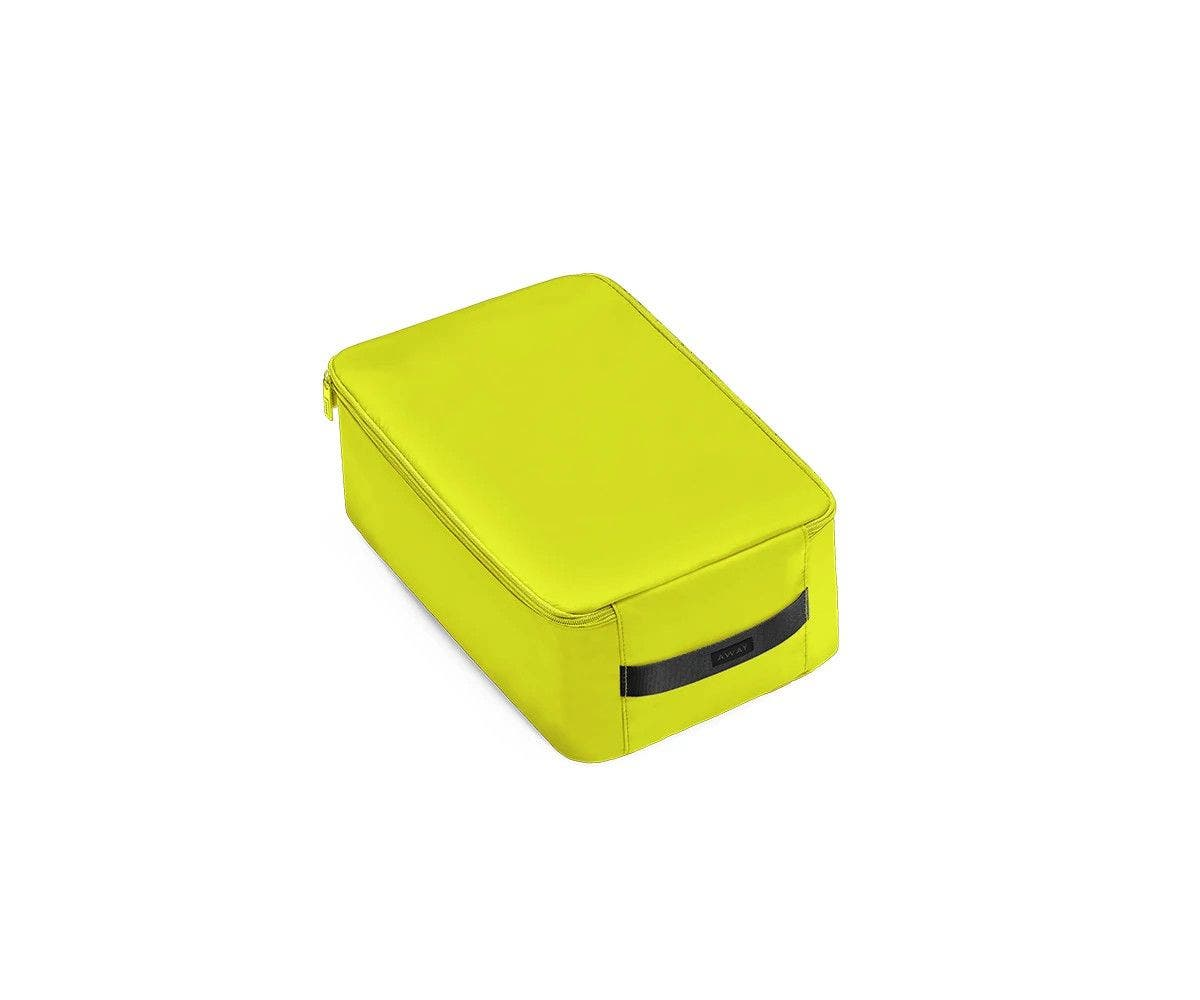 A angled view of a small lime green shoe cube.