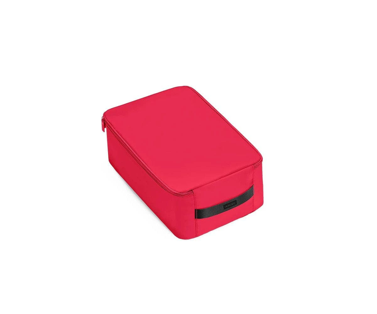 A angled view of a small electric magenta shoe cube.