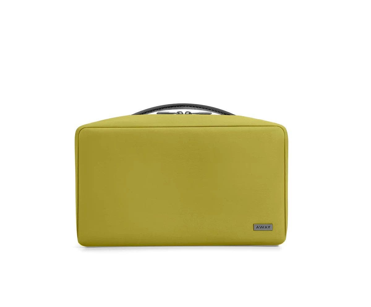 Large travel toiletry bag in the color pistachio green.