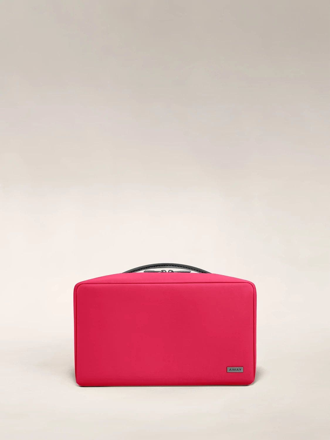 Large travel toiletry bag in the color electric magenta.