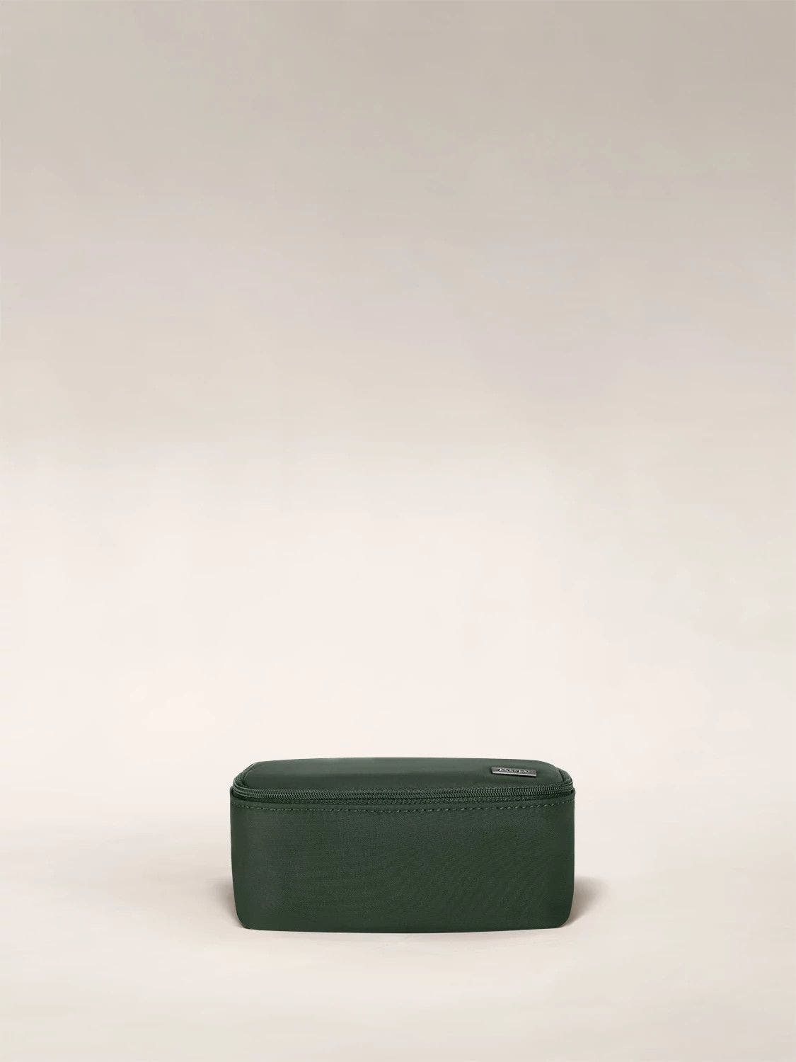 A travel tech organizer case from Away in green.
