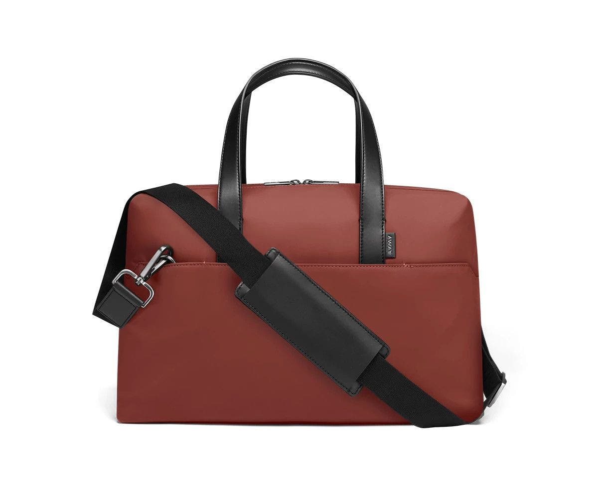 Brick duffle with back zip pocket, and shoulder strap across the bag.