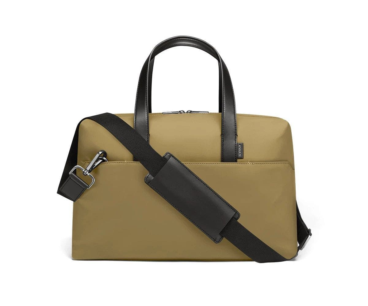 Olive duffle with back zip pocket, and shoulder strap across the bag.